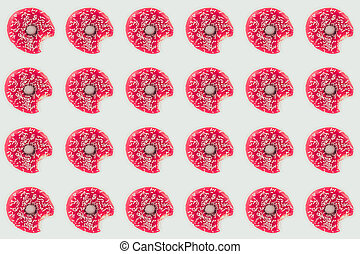 top view of bitten pink doughnuts seamless pattern isolated on white