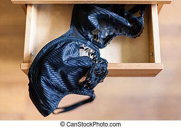 black brassiere in open drawer