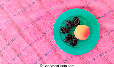 Top View of Black Mulberries With Peach