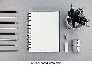 blank notepad and office supplies on recycled paper background