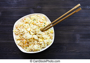 top view of bowl with Fried Rice with chopsticks