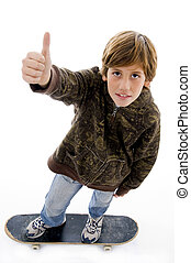 top view of boy riding skateboard and showing thumbs up