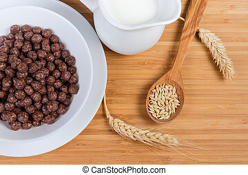 Top view of breakfast cereal chocolate balls and milk closeup