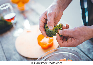 Top view of broccoli in male hands