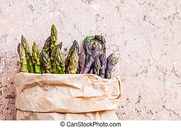 Top view of bunch of fresh purple and green asparagus spears...