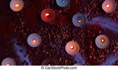 Top view of burning tealight candle grouped together on red background. Romantic atmosphere with scented aroma tea light candles. Valentines background. Love