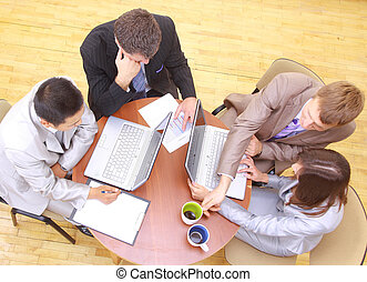 Top view of business people sitting in the meeting