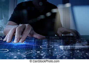 top view of businessman hand working with modern technology and digital layer effect as business strategy concept