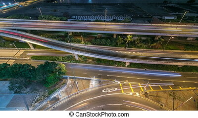 Top view of busy traffic night in finance urban timelapse, hong kong city