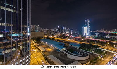 Top view of busy traffic night in finance urban timelapse hyperlapse with panorama of city buildings, hong kong city