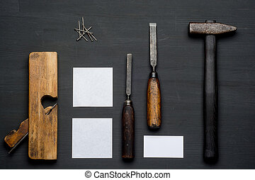 Top view of carpenter tools equipment set on wooden table.