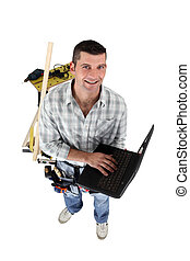 Top-view of carpenter with laptop