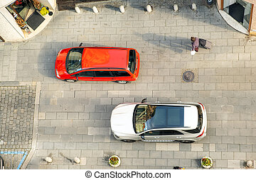 Top view of cars driving on a city street.