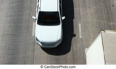 Top view of cars driving on street in a city