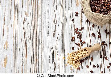 cedar nuts in sack and scoop