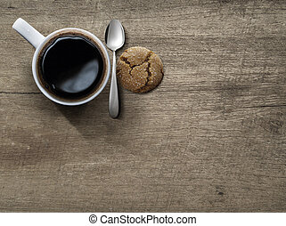 Top view of ceramic cup of coffee on wood table
