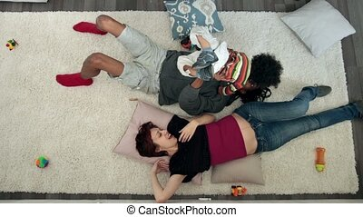 Top view of cheerful family with son having fun