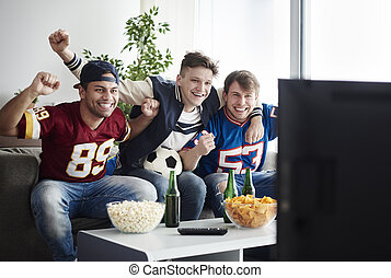 Top view of cheering guys at home