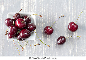 Top view of cherries in white bowl