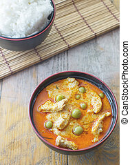 top view of chicken red curry with rice