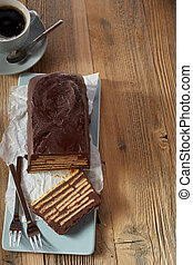 Top view of chocolate cake on wooden table