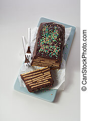 Top view of chocolate cake with biscuits