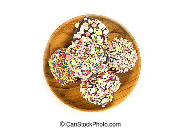 Top view of chocolate cupcake in wooden plate