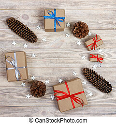 top view of Christmas gifts and cones with decorations