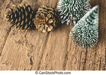 Top view of Christmas tree and gold pine cone on grunge wood table. winter holiday greeting card. leave space for adding text.