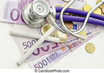 Top view of ciarettes and stethoscope on Euro money