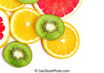 Top view of citrus slices - kiwi, oranges and grapefruits isolated on white background with copy space. Fruits backdrop