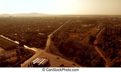 Top view of city and road on a summer day.