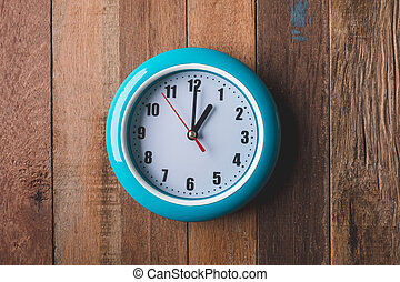Top view of Clock on wooden table background.
