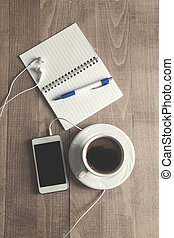 Top view of coffe ,notepad with pen and phone