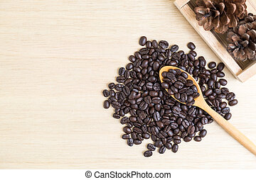 Top view of coffee beans on wooden spoon