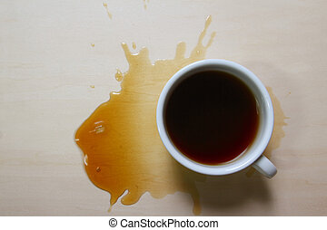 Top view of coffee cup and stains on wooden board