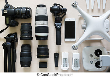 Top view of collection of photograph equipment with camera, camcorder, lens and drone