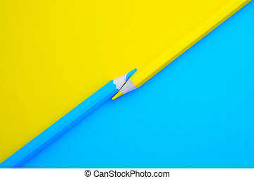 top view of color pencils on color background