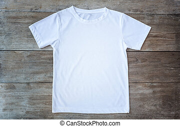 Top view of color T-Shirt on grey wood plank background