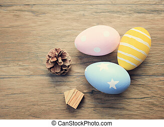 Top view of colorful easter eggs on wooden background with retro