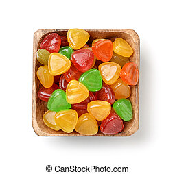 Top view of colorful hard candies in wooden bowl