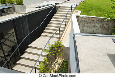 Top view of concrete stairs with garden