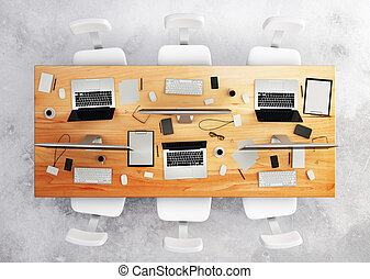 top view of conference table with office accessories and computers