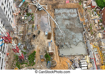 Top view of construction site with cranes