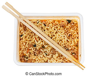 top view of cooked instant ramen and wooden chopsticks in...