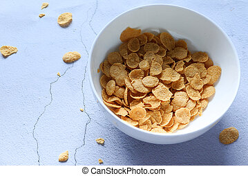 Top view of corn flakes in a bowl on table