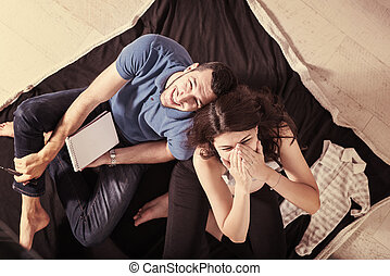 top view of couple checking a list of things for their unborn baby
