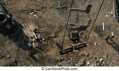 Top view of crane with cement tank rising up on building site