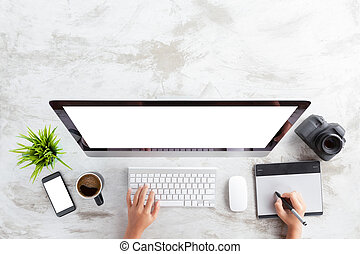 top view of creative photographer using graphic tablet on work table