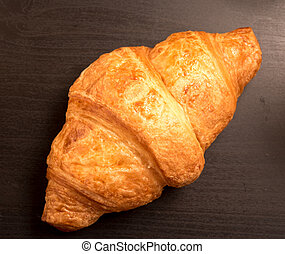 top view  of Croissant on a black background